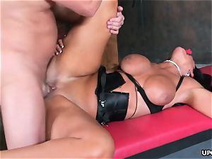 caged dark-haired deepthroats bone and receives stiff pummeling