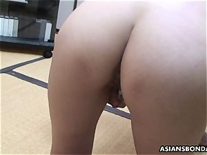 japanese sadomasochist fucktoys her fur covered cooter while being lashed