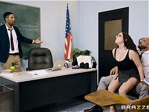professor Angela milky filled ball sack deep in her classroom