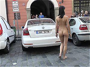 youthful bombshell woman Dee on Czech streets downright bare